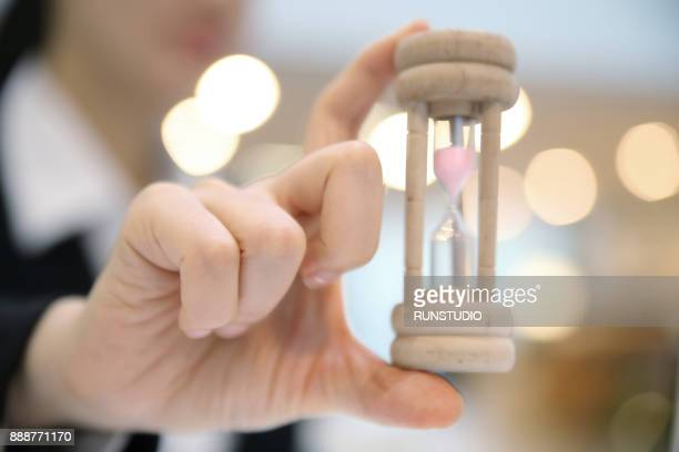 Businesswoman showing hourglass