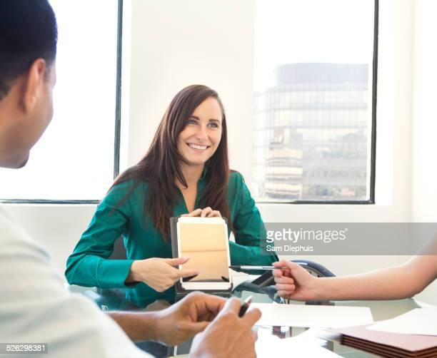 Businesswoman showing work in meeting