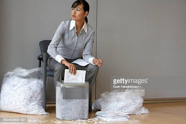 businesswoman shredding documents - shredded stock pictures, royalty-free photos & images