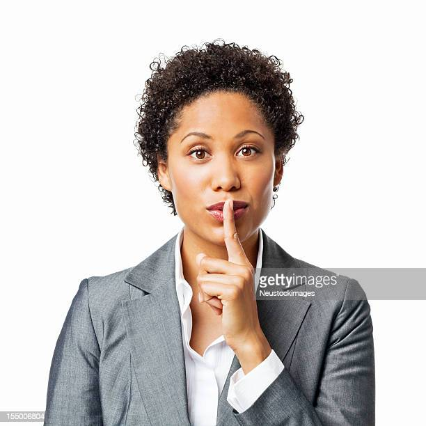 businesswoman shushing the camera - isolated - finger on lips stock pictures, royalty-free photos & images