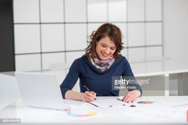 Businesswoman signing contract in office