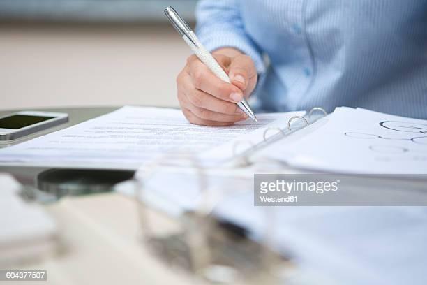 Businesswoman signing document