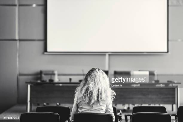 Businesswoman sitting alone in the conference room