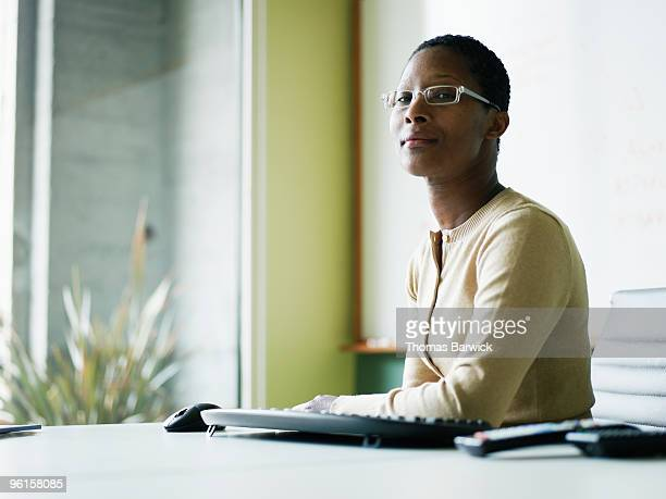 Businesswoman sitting at conference room table