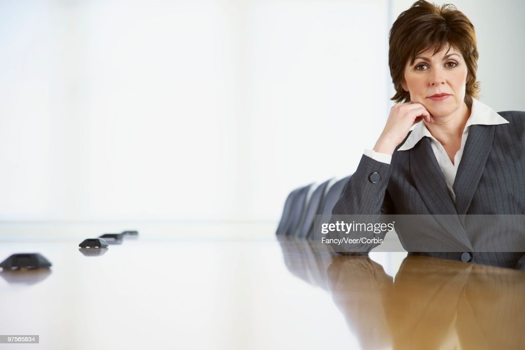 Businesswoman Sitting at Conference Table : Photo