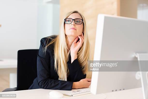 businesswoman sitting at her desk