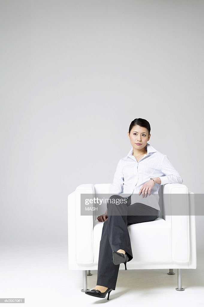 Businesswoman Sitting in an Armchair : Stock Photo