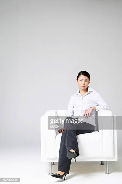 Businesswoman Sitting in an Armchair