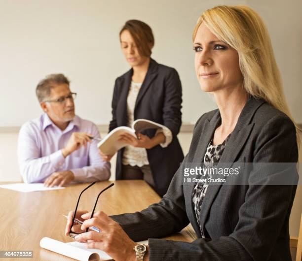 businesswoman sitting in meeting - tensed idaho stock photos and pictures