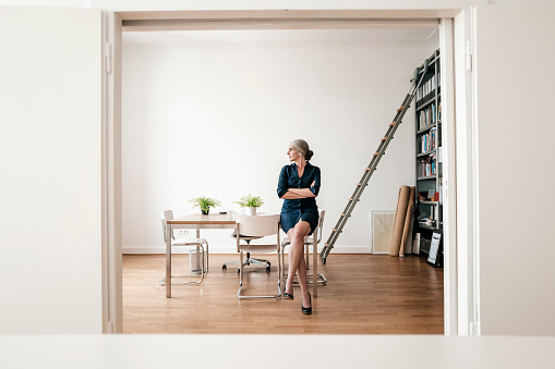 Businesswoman sitting in modern office - gettyimageskorea