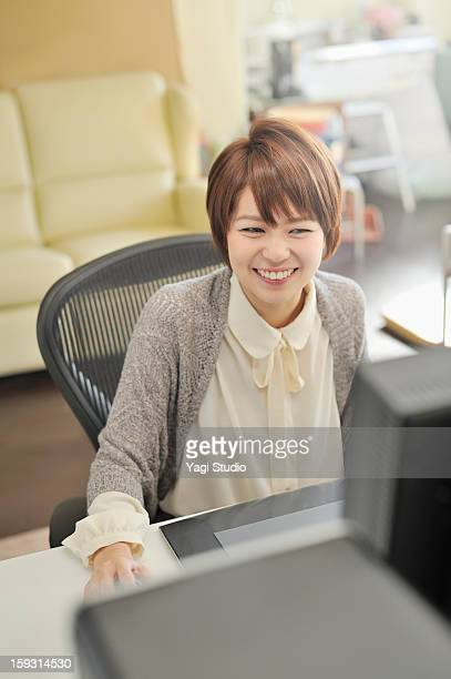 Businesswoman sitting in office,smiling
