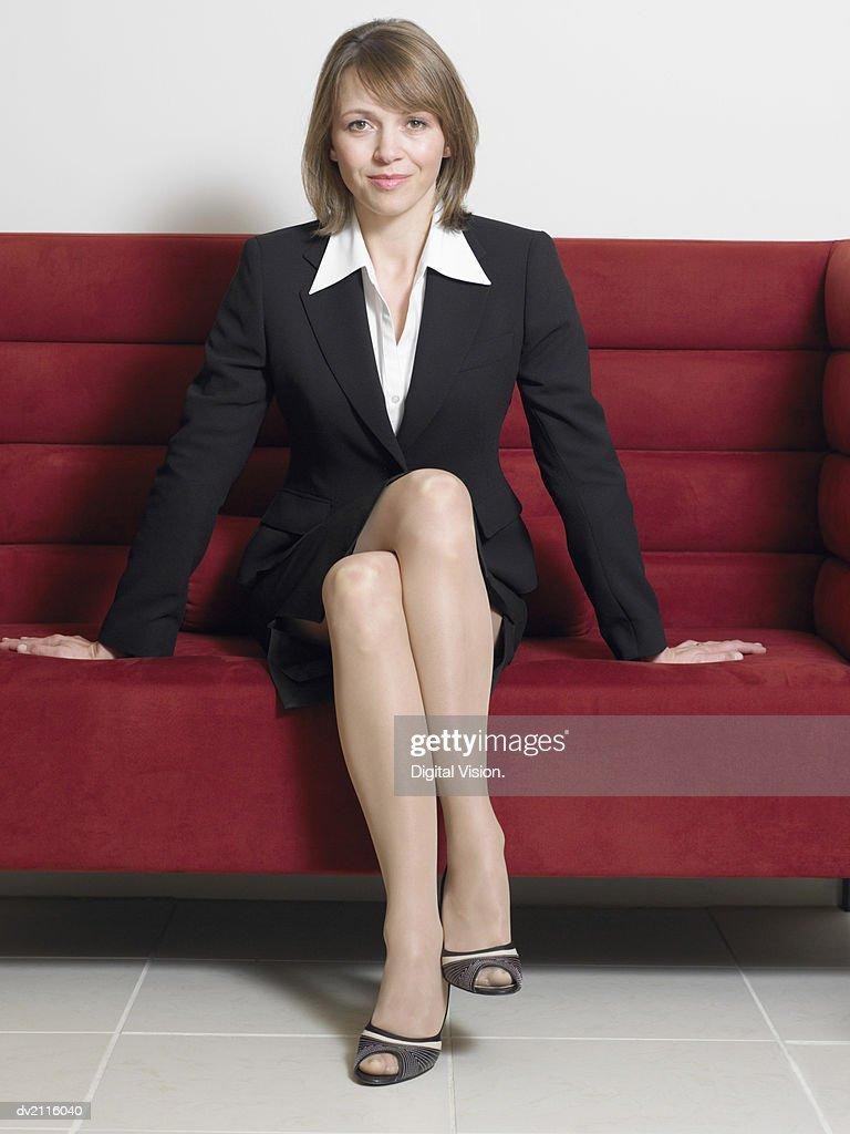 Businesswoman Sitting on a Sofa : Stock Photo