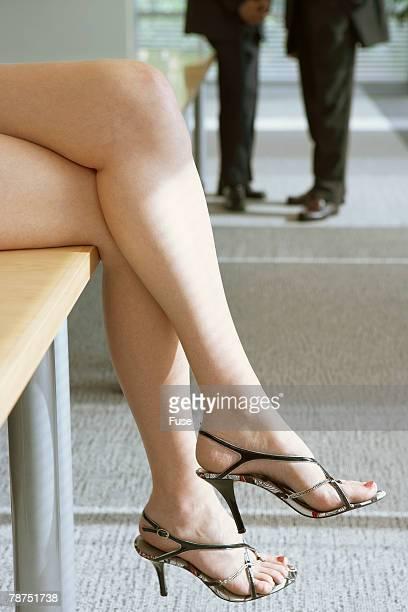 Businesswoman Sitting on Desk