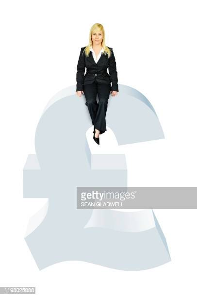 businesswoman sitting on pound symbol - graphic accident photos stock pictures, royalty-free photos & images