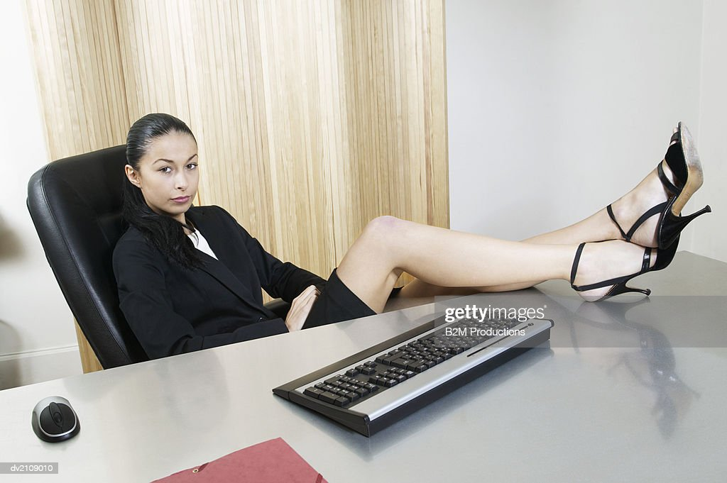 Businesswoman Sitting With Her Feet up : Stock Photo