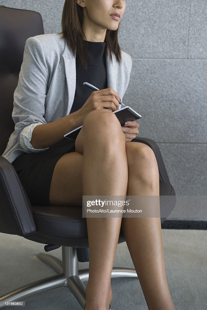 Businesswoman Sitting With Legs Crossed Cropped