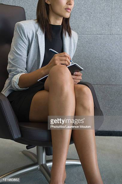 businesswoman sitting with legs crossed, cropped - secretary stock photos and pictures