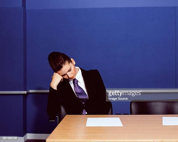 Businesswoman sleeping in office