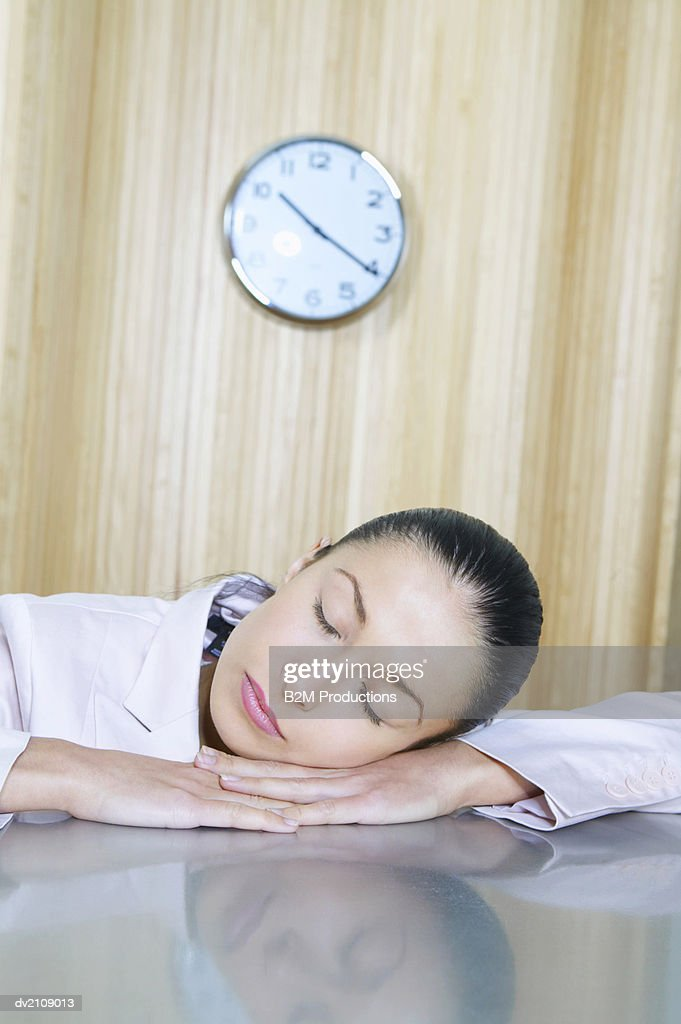 Businesswoman Sleeping on a Desk : Stock Photo