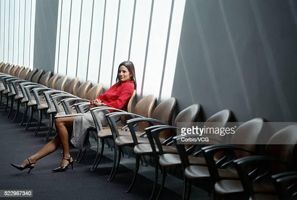 Businesswoman Slumped Down in Chair