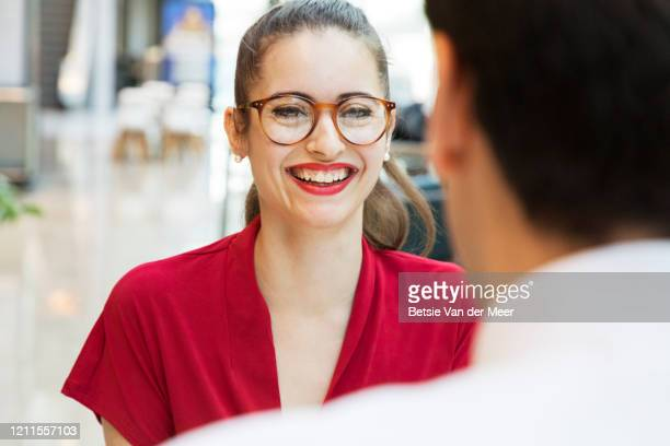 businesswoman smiles at colleague, over the shoulder view. - make up stock pictures, royalty-free photos & images