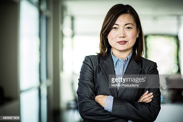 businesswoman smiling at camera - korean ethnicity stock pictures, royalty-free photos & images