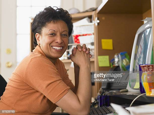Businesswoman smiling for the camera at her desk