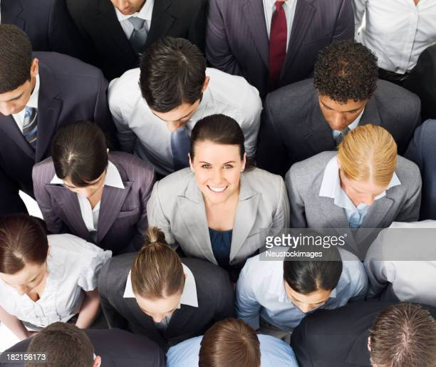 Businesswoman Smiling in a Crowd