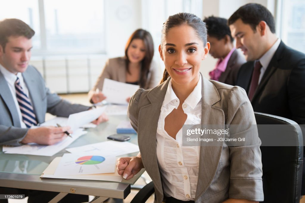 Businesswoman smiling in meeting : Stock Photo