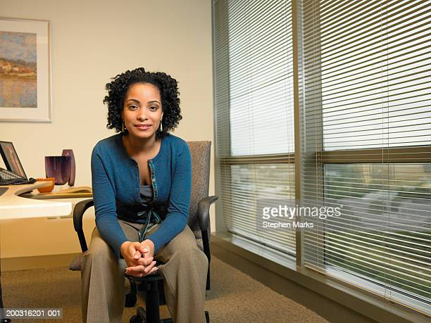Businesswoman smiling in office, portrait