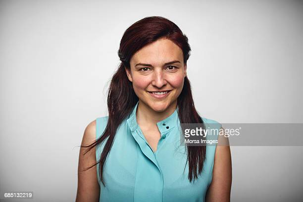 businesswoman smiling over white background - part of a series stock pictures, royalty-free photos & images