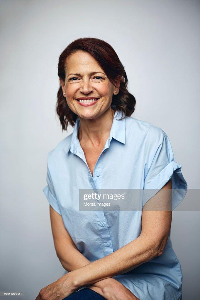 Businesswoman smiling over white background : Foto de stock
