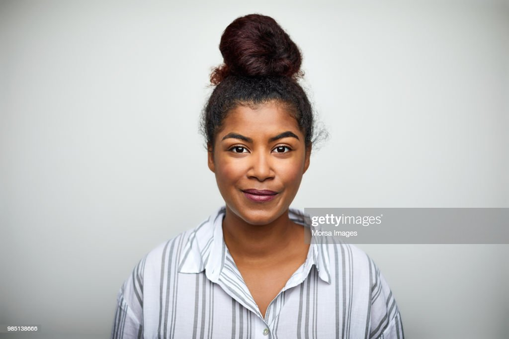 Businesswoman smiling over white background : Foto de stock