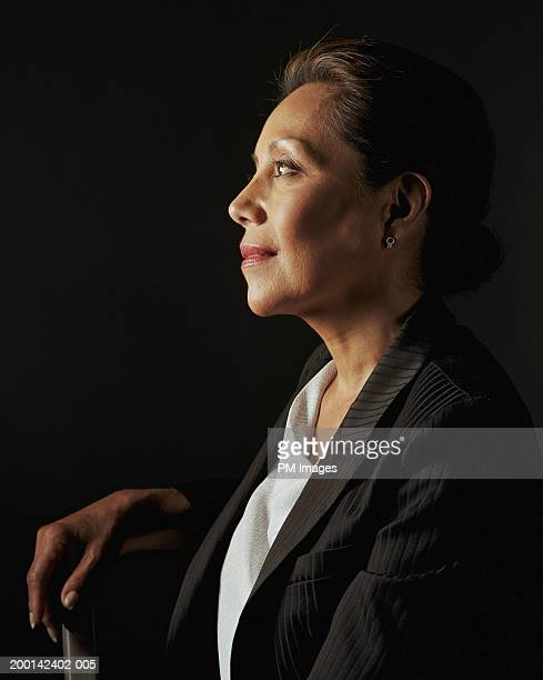 Businesswoman smiling, side view