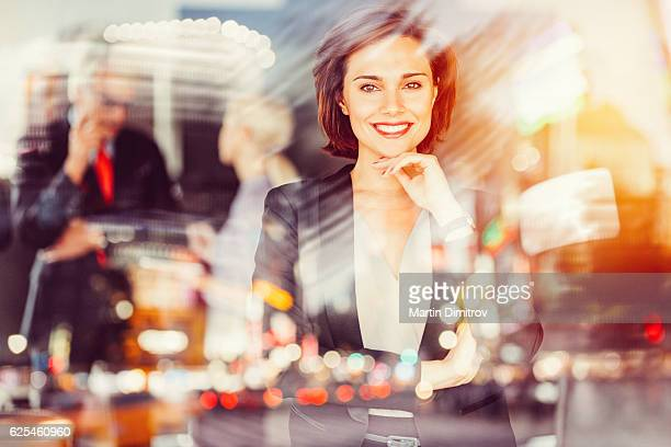 Businesswoman smiling to the camera