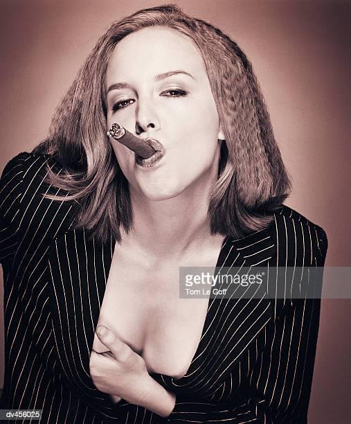 Businesswoman smoking cigar