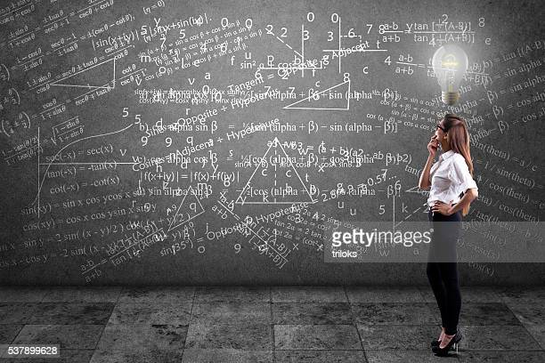 Businesswoman solving mathematical equation