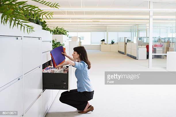 Businesswoman Sorting File Folders