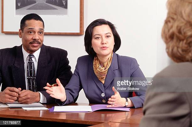 businesswoman speaking at executive meeting - female execution photos stock pictures, royalty-free photos & images
