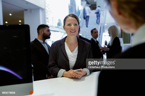 Businesswoman Speaking To A Hotel Receptionist
