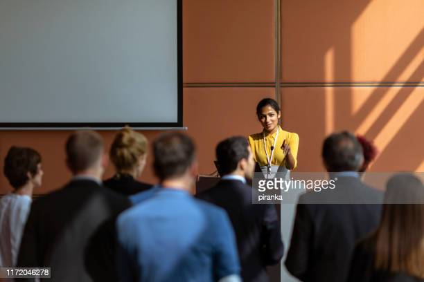 businesswoman speaking to the audience - press conference stock pictures, royalty-free photos & images