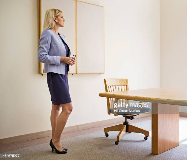Businesswoman standing at table in conference room