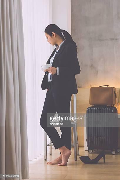 businesswoman standing by window