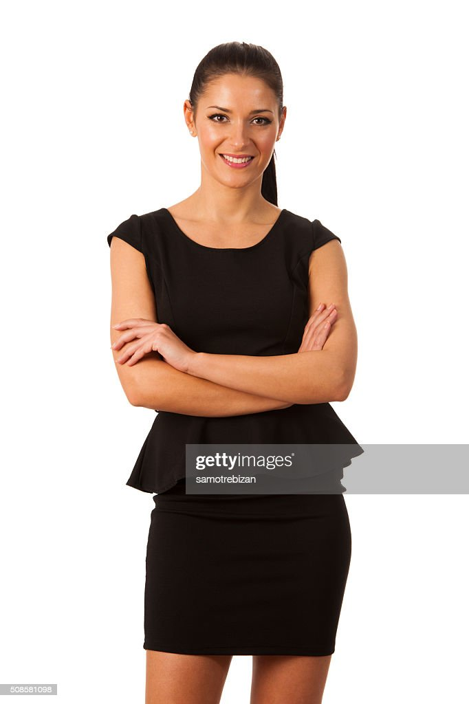 Businesswoman standing full of success, pride and confidence : Stock Photo
