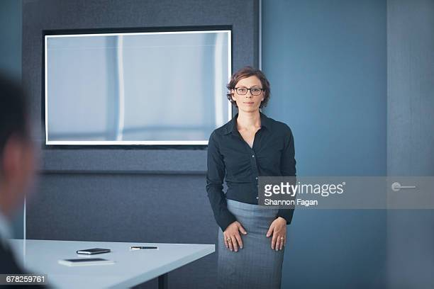 Businesswoman standing in business office