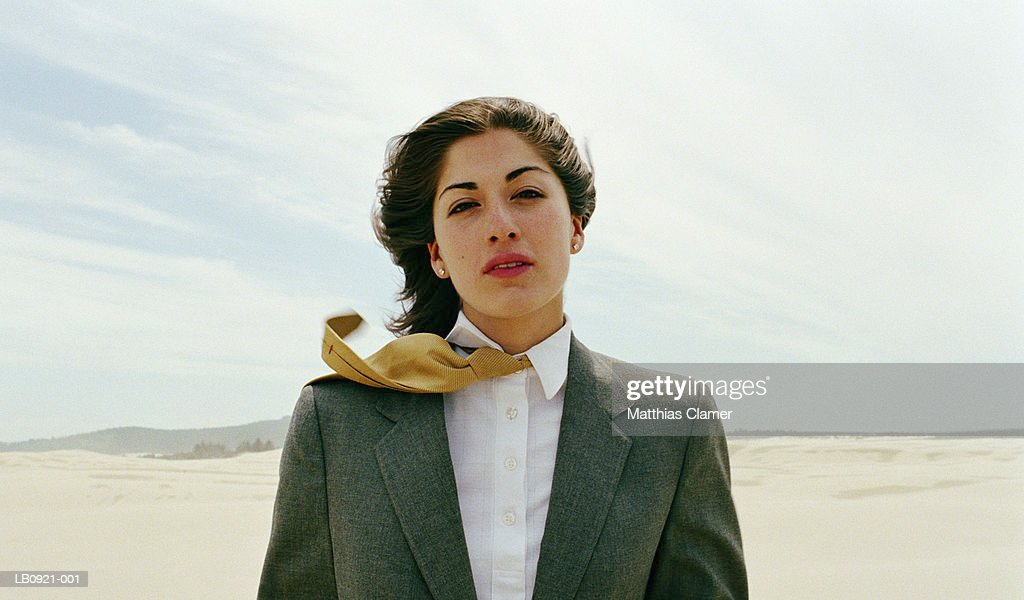 Businesswoman standing in desert, portrait : Stock Photo