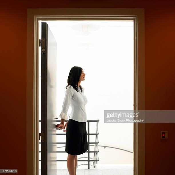 Businesswoman standing in doorway