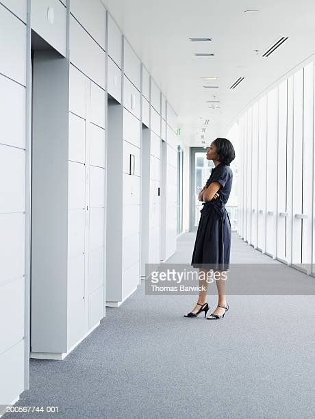Businesswoman standing in front of elevator