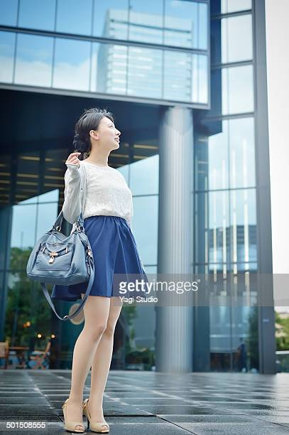 Businesswoman standing in front of the building