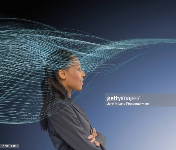 businesswoman standing in light stream - data stream fotografías e imágenes de stock